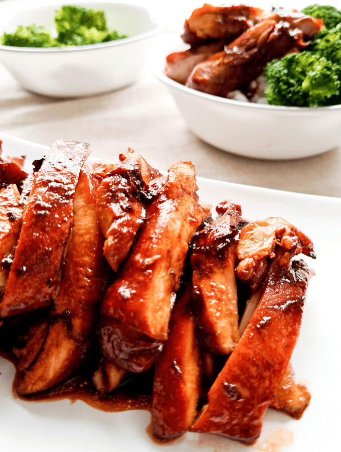 Close up of sliced teriyaki chicken thighs, saucy