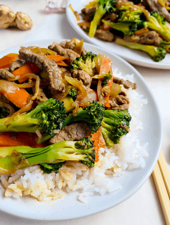 Serve Chinese beef and vegetables stir fry with steamed rice
