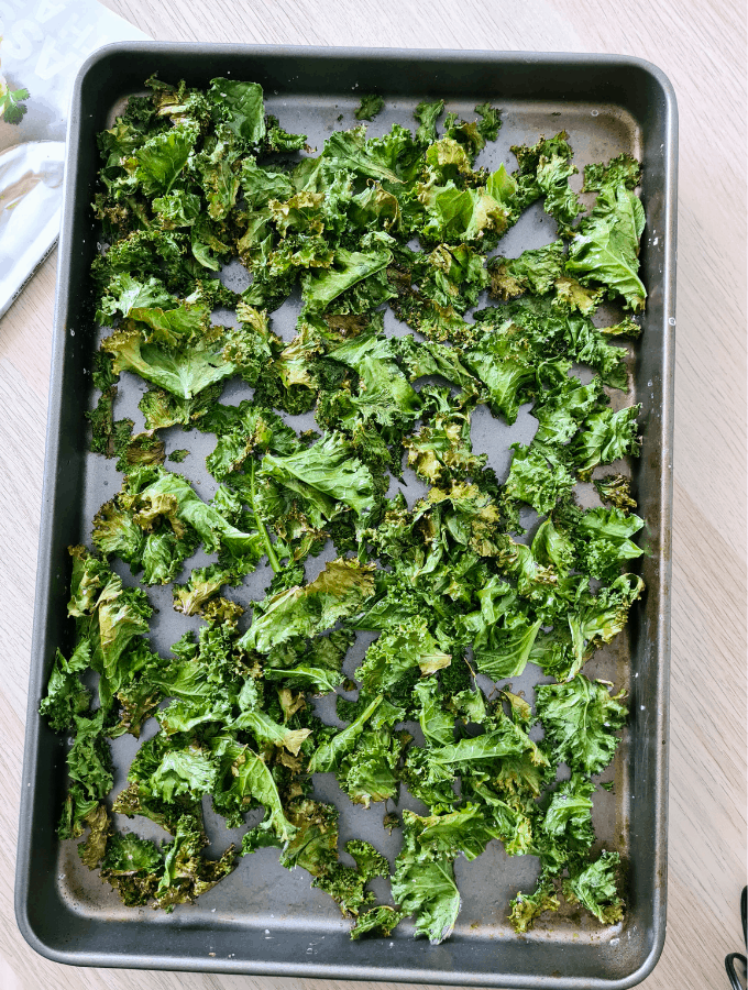 oven cooked crispy kale chips in a tray