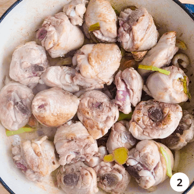 browned chicken pieces in a pan