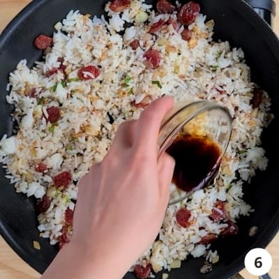 Soy sauce added into fried rice