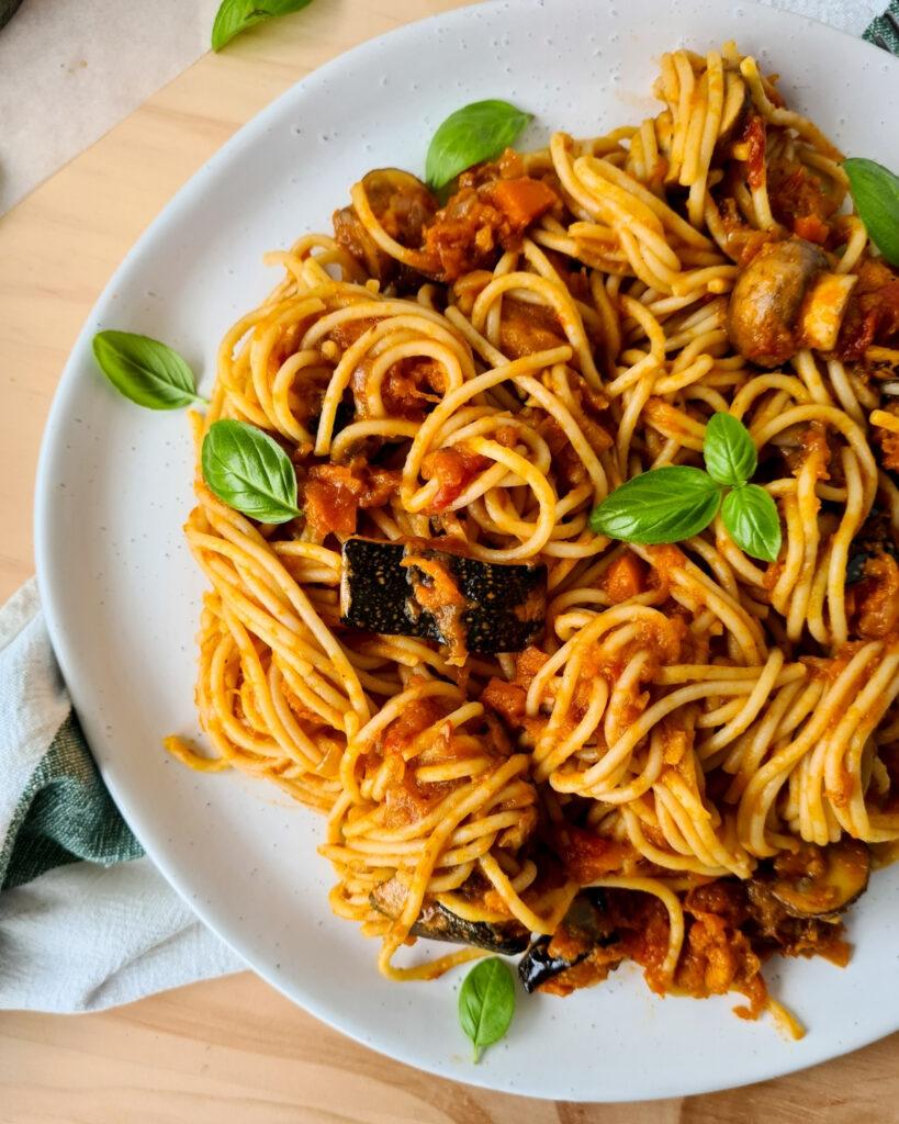 Side image of plate of spaghetti vegetarian bolognese