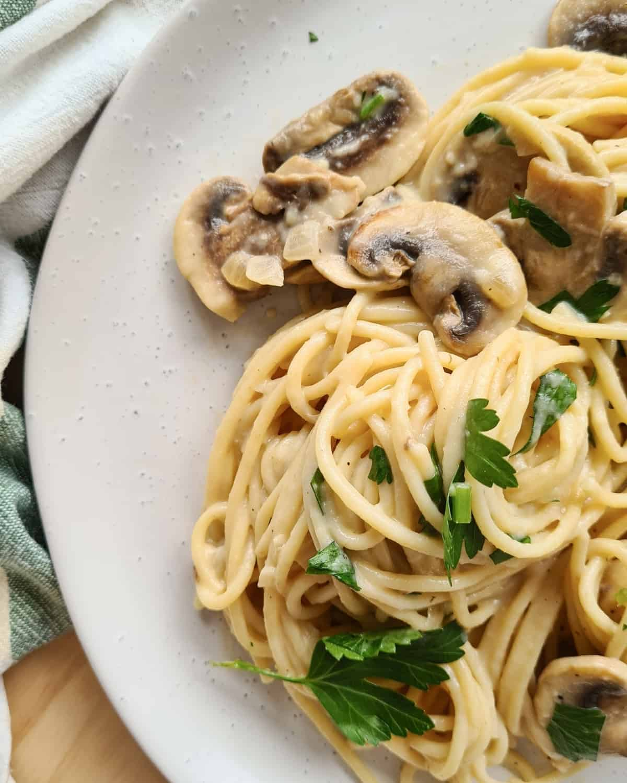Close up image of creamy mushroom pasta on a plate
