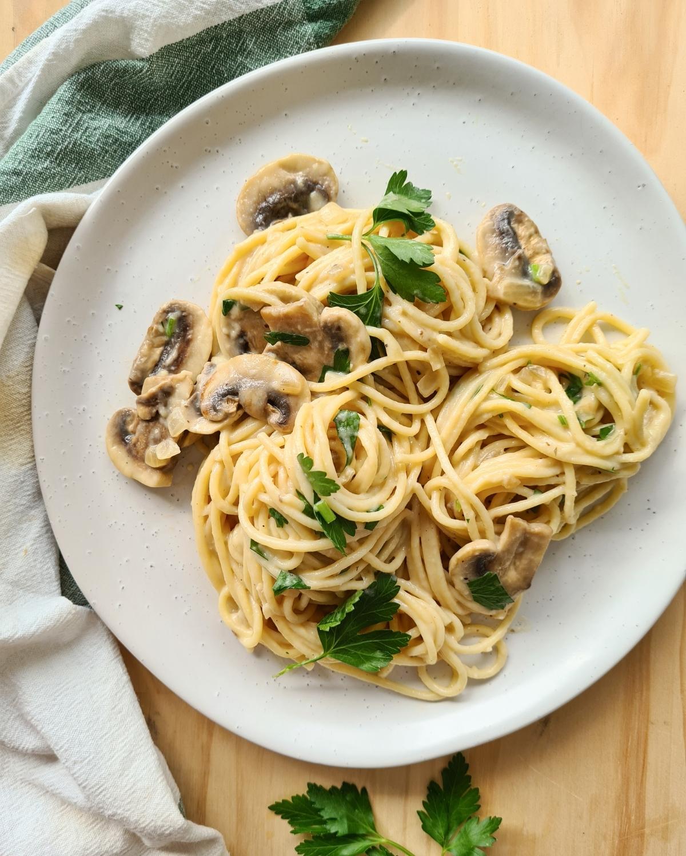 A plate of creamy mushroom pasta