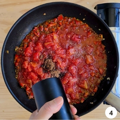 crushed tomatoes into the pan with other seasoning