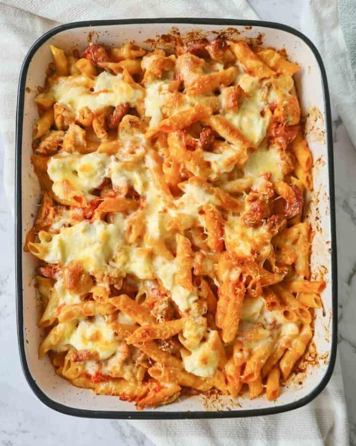 Full tray of freshly baked golden chicken and chorizo pasta bake