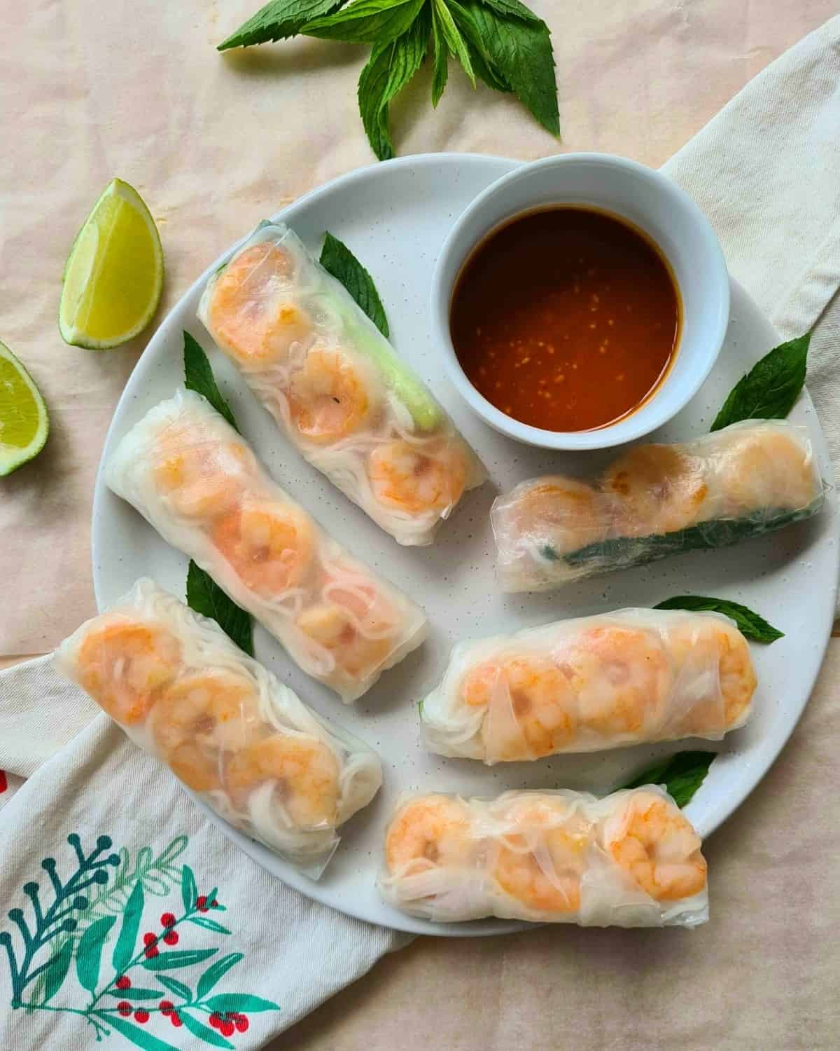 Full plate of rice paper rolls with sauce