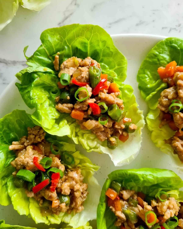 San choy bow (lettuce wraps) on a plate ready for serve