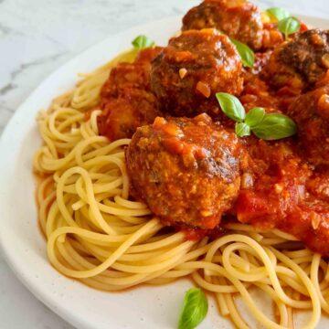 close up of spaghetti and meatballs