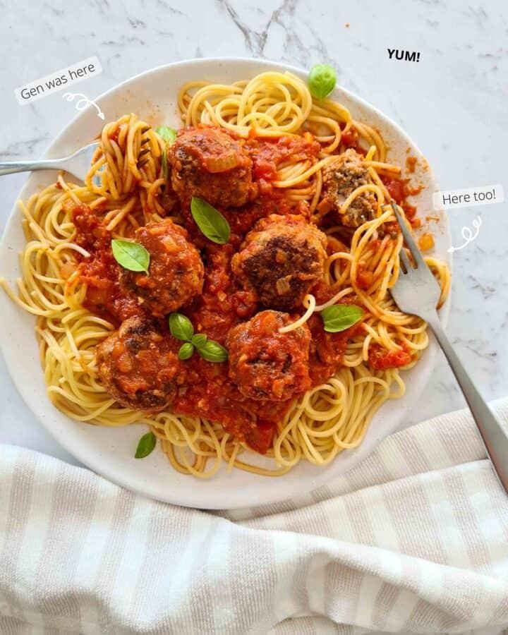 Half eaten plate of spaghetti and meatballs