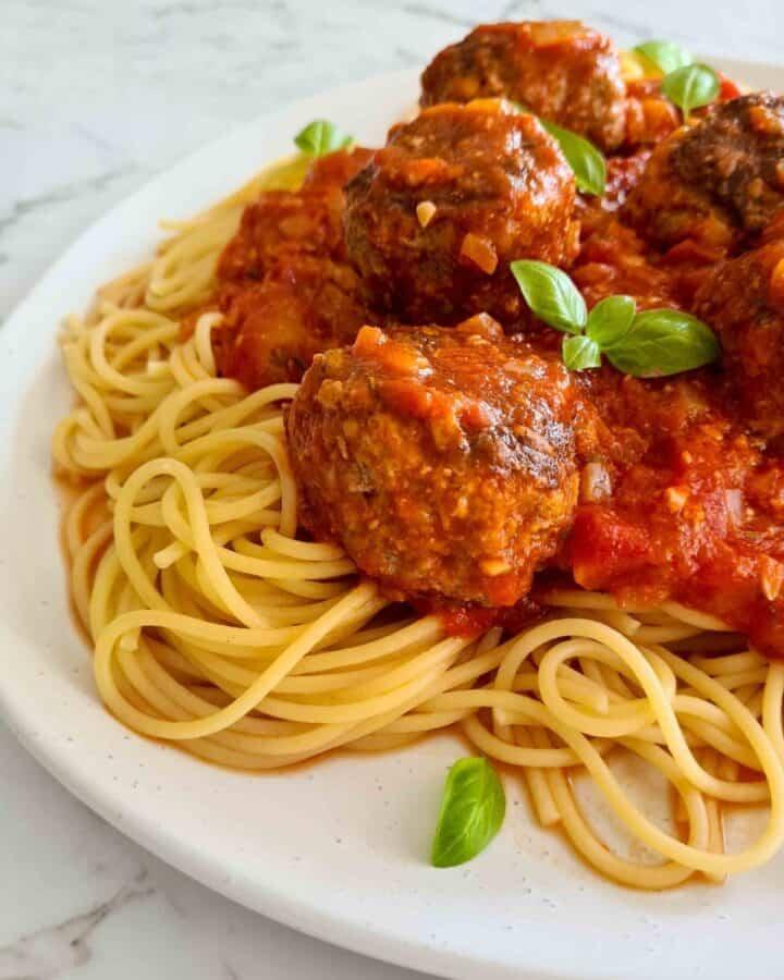 Close up side profile of spaghetti and meatballs