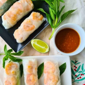 Close up of rice papper rolls with dipping sauce
