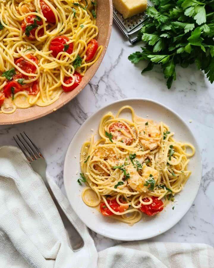 A plate of creamy garlic prawn pasta ready for serve