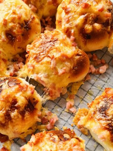 freshly baked cheesy cheese and bacon rolls