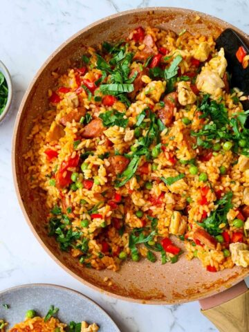 A pan of chicken paella ready for serve