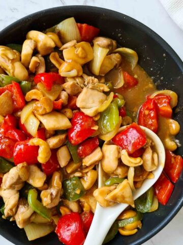 Close up of Chinese cashew chicken in a pan