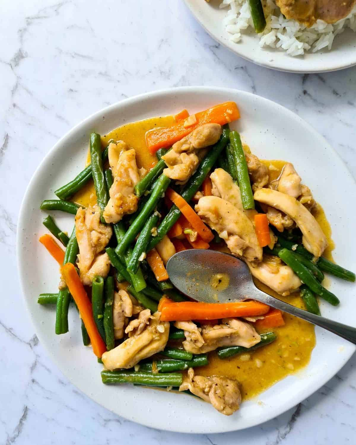 Plateful of chicken and vegetable stir fry being served
