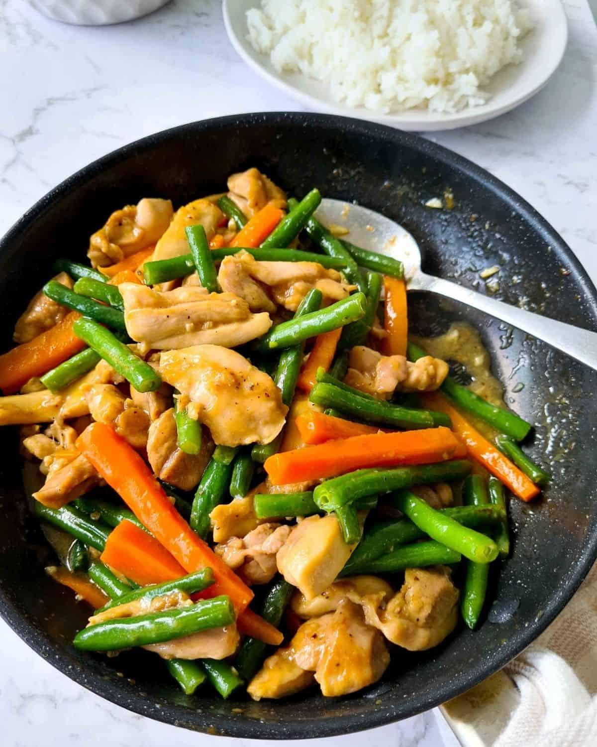 Cooked marinated chicken stir fry in a pan