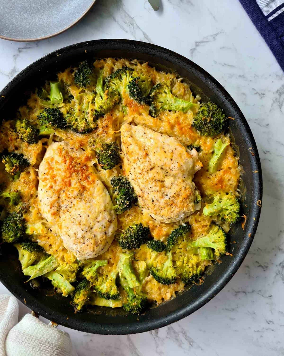 Overhead shot of a pan of freshly baked chicken and broccoli risoni
