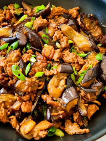 Close up of a pan of cooked Chinese eggplant and minced pork