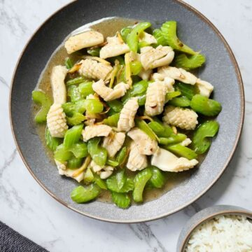 Squid and celery stir fry on a large grey plate
