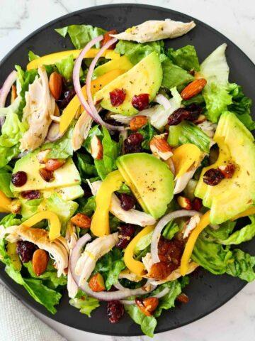 Chicken salad no a black plate