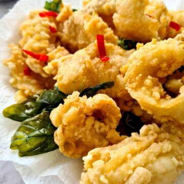 Freshly fried crunchy squid on top of kitchen paper