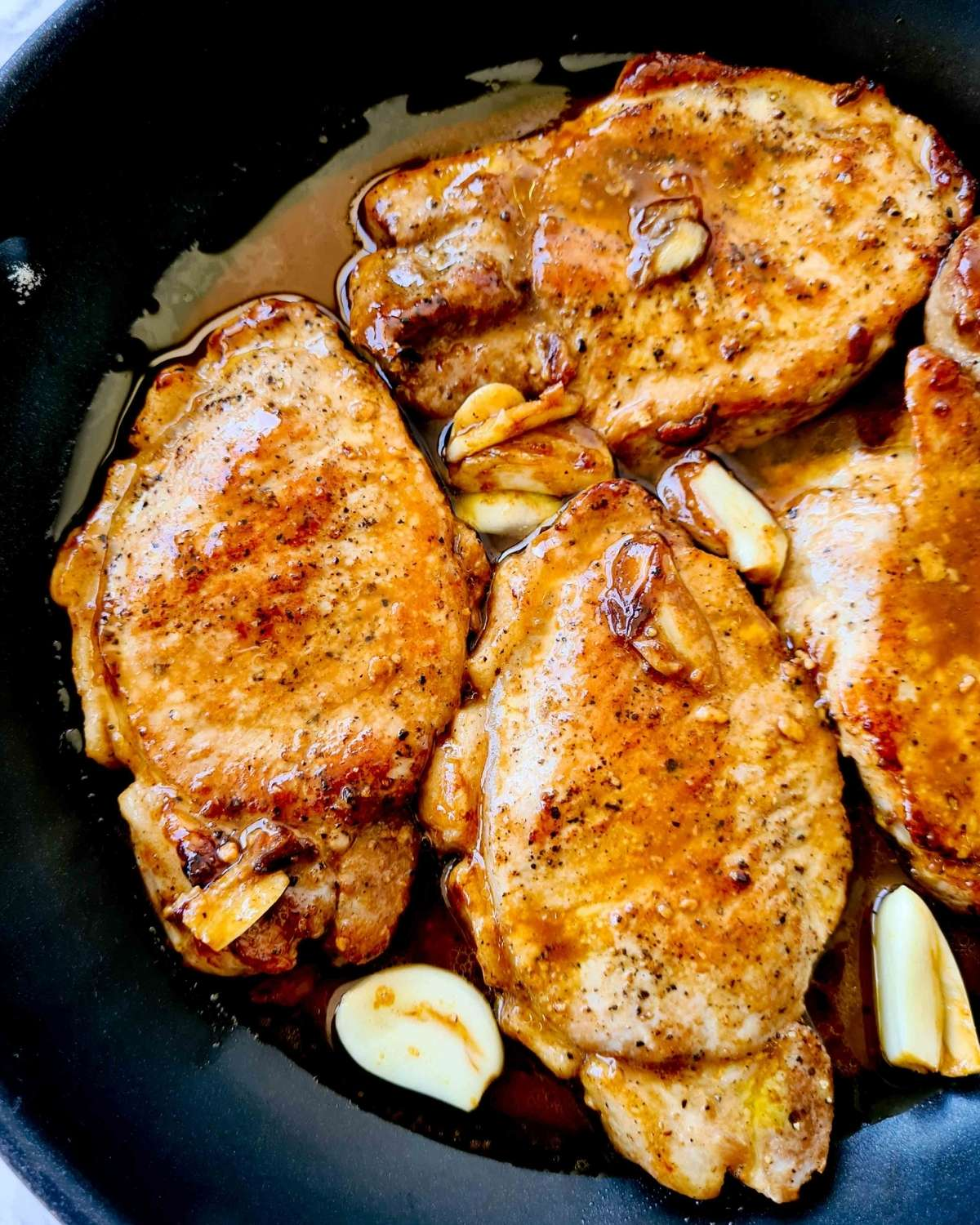 Close up of cooked pork chops in sauce