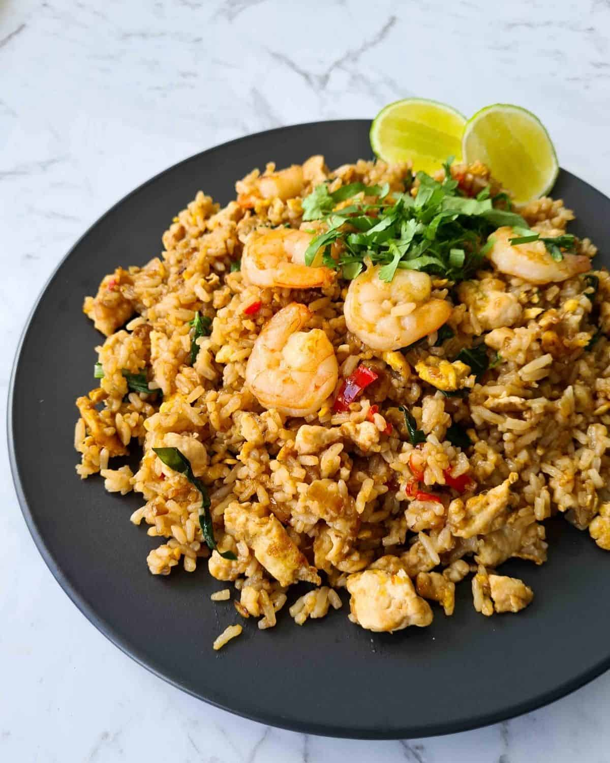 Side view of fried rice, visibly showing prawns, coriander and details in the fried rice