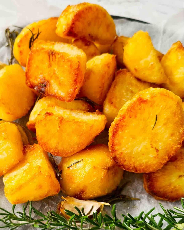 Close up of a pile of crispy golden duck fat potatoes