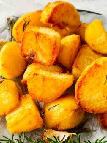 Close up of golden crunchy roasted potatoes