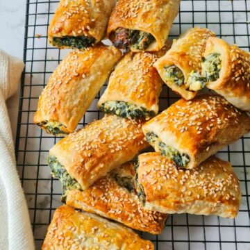 party sized spinach ricotta rolls on a cooling rack