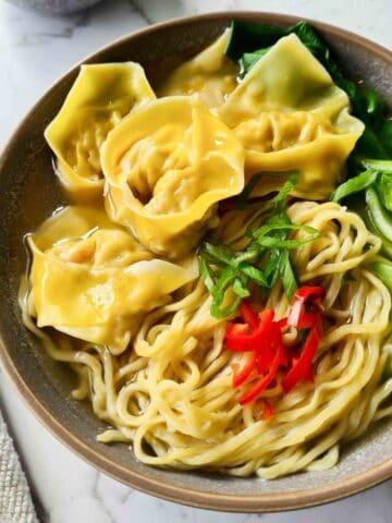 A bowl of wonton noodle soup