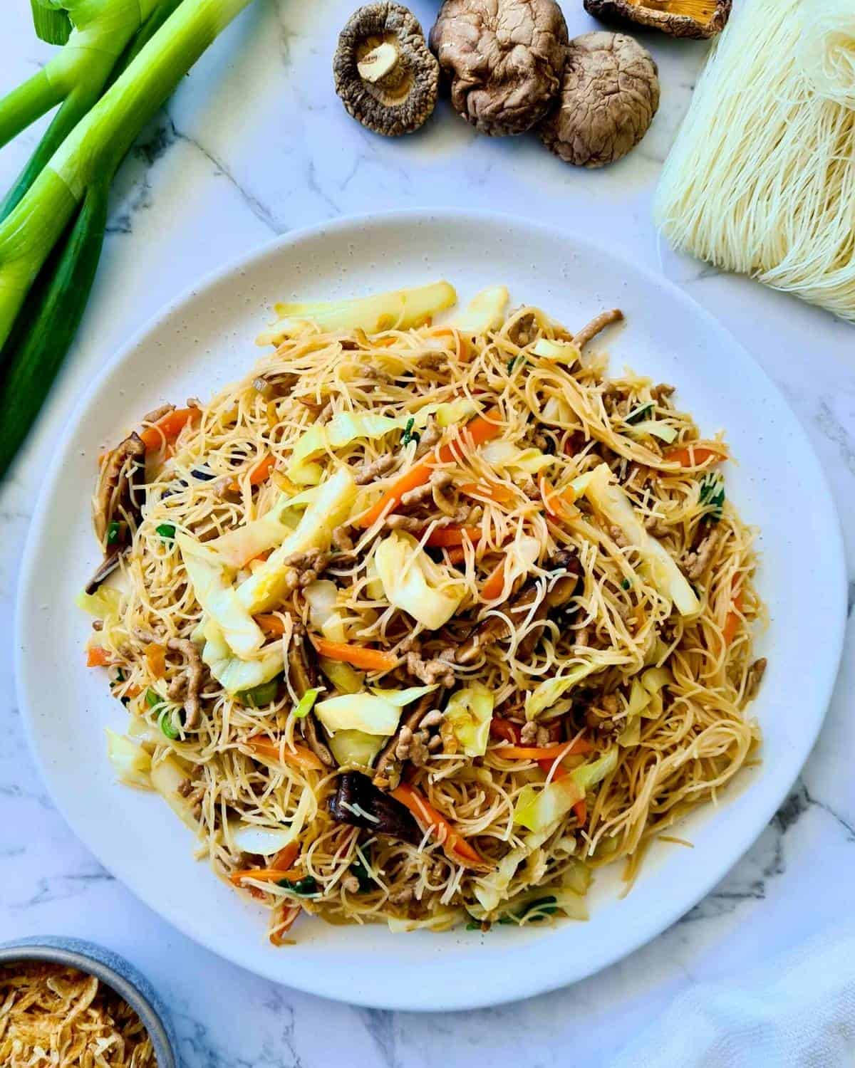 cooked noodles stir fry in a large white plate