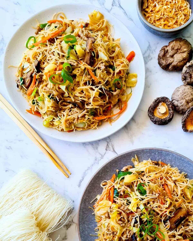 2 serving plates of tsao mi fun (Taiwanese vermicelli stir fry)