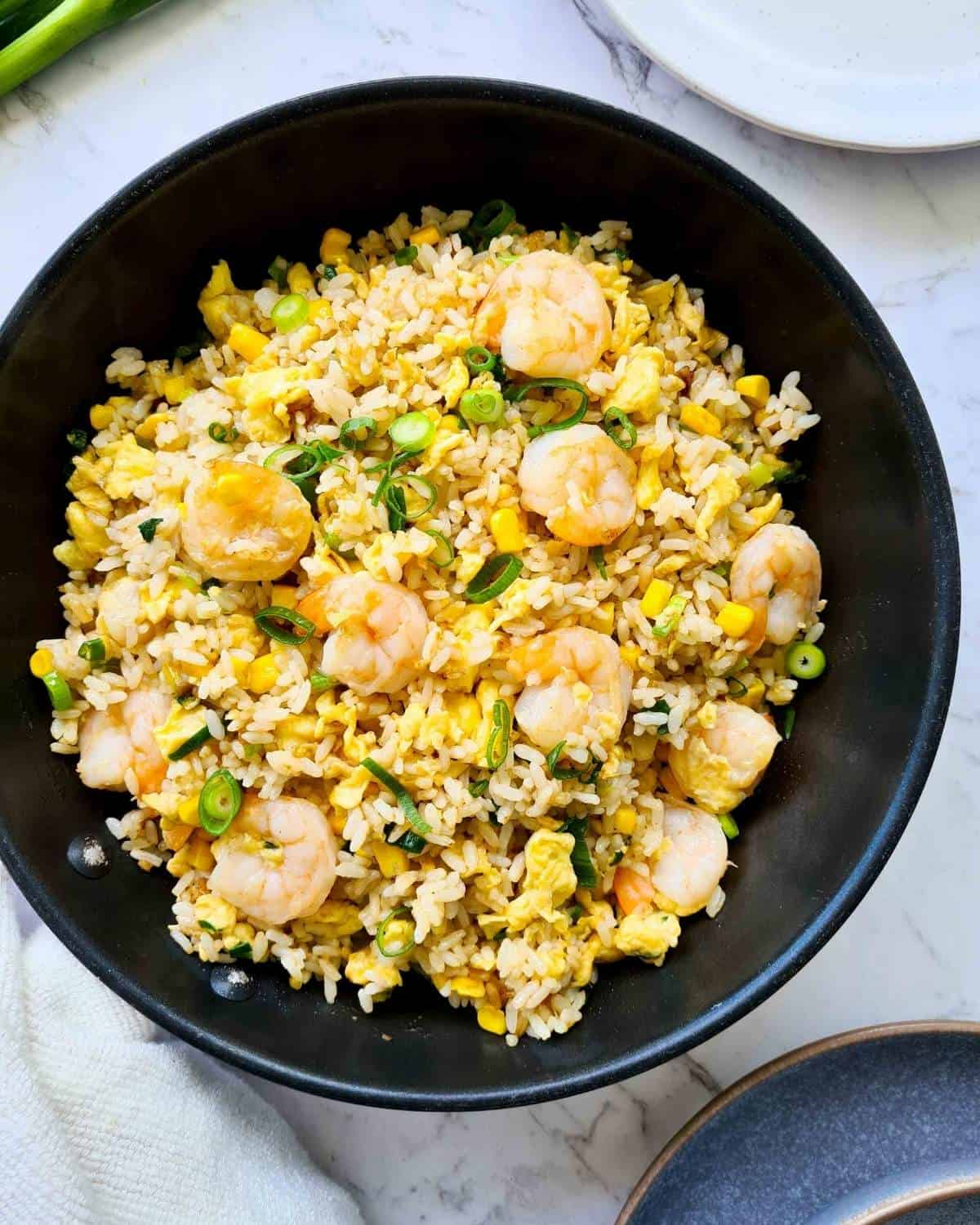 Freshly made fried rice in a black frying pan